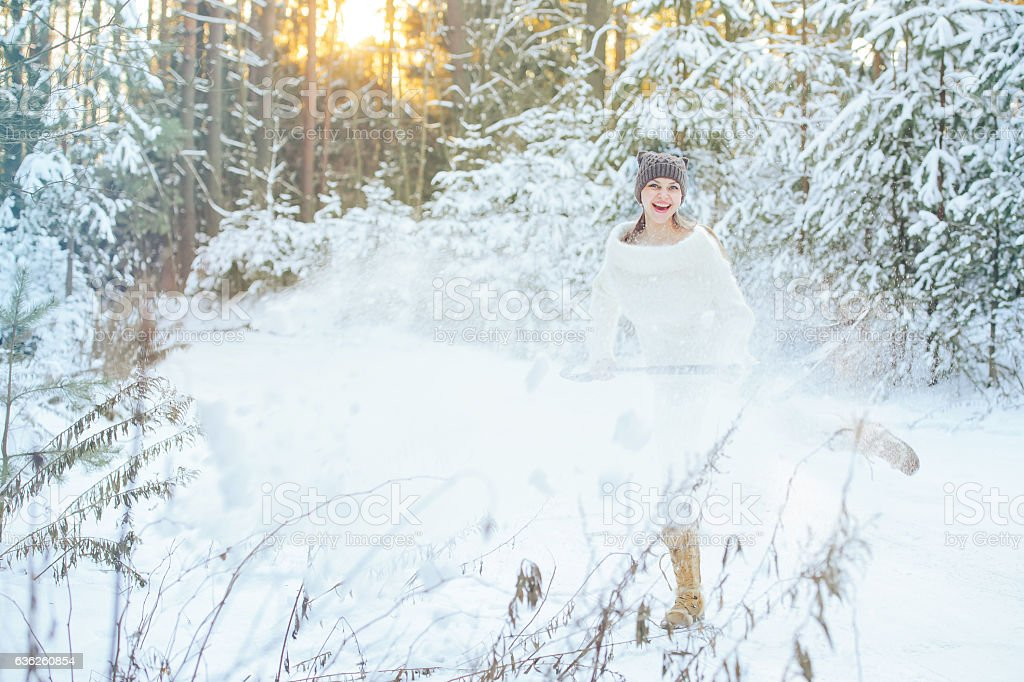 women with a shovel in the winter forest stock photo