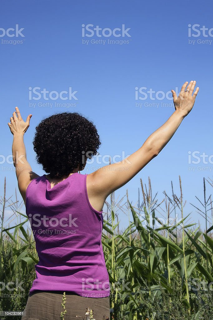 women with arms up royalty-free stock photo