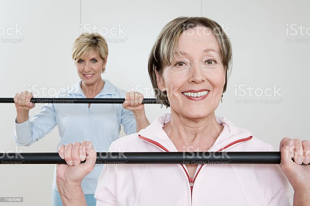 Women with barbells royalty-free stock photo