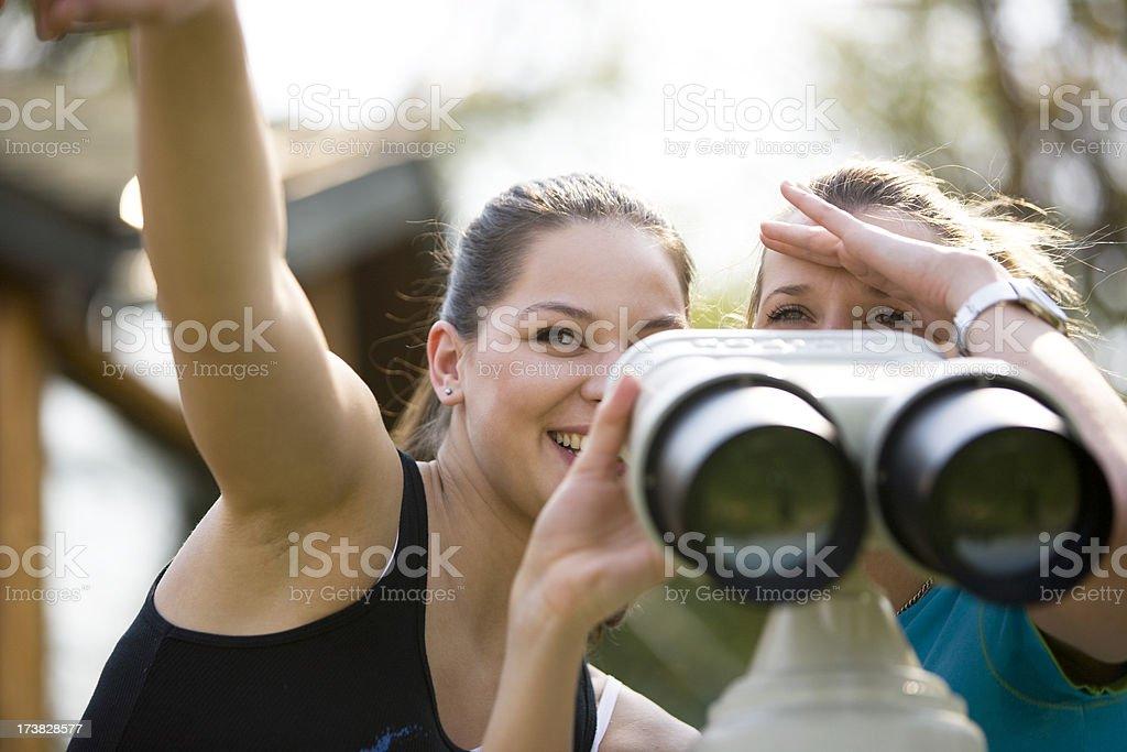 Women with binoculars royalty-free stock photo