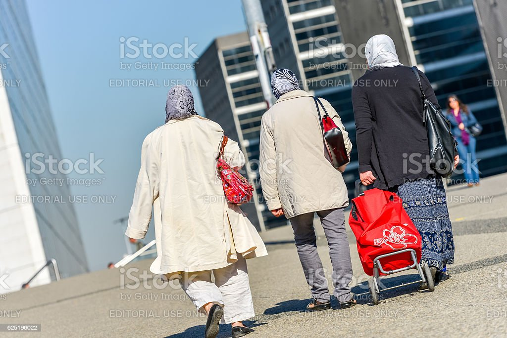 women with chador walking in a street stock photo