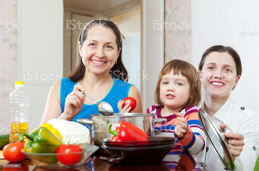 women  with child  cooking veggie lunch royalty-free stock photo