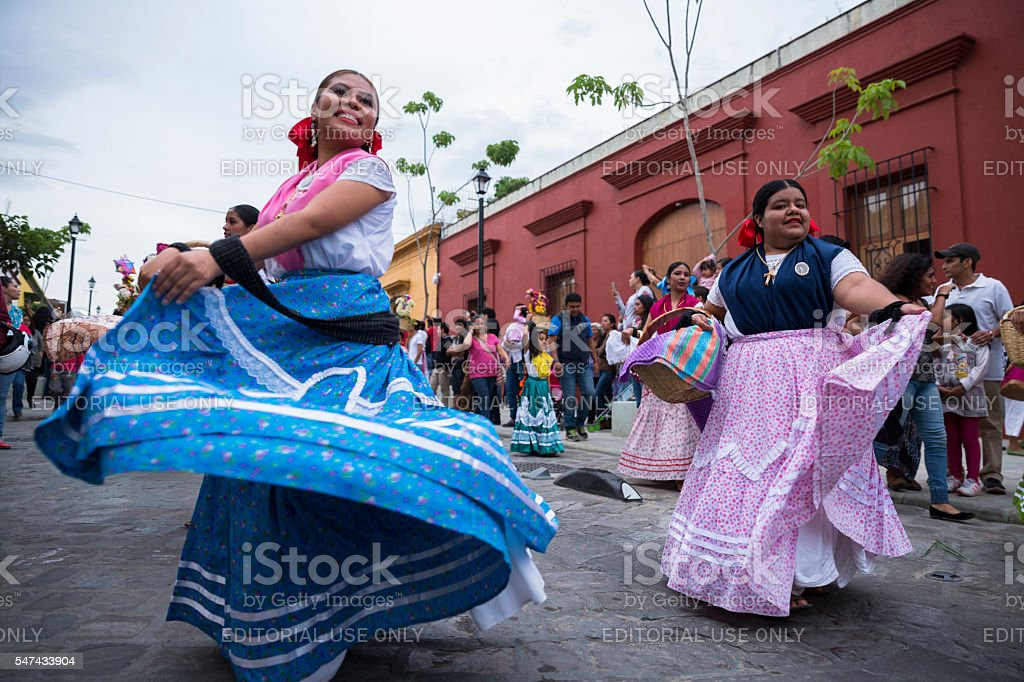 Women with China oaxaqueña traditional costume dancing for Guelaguetza celebration stock photo