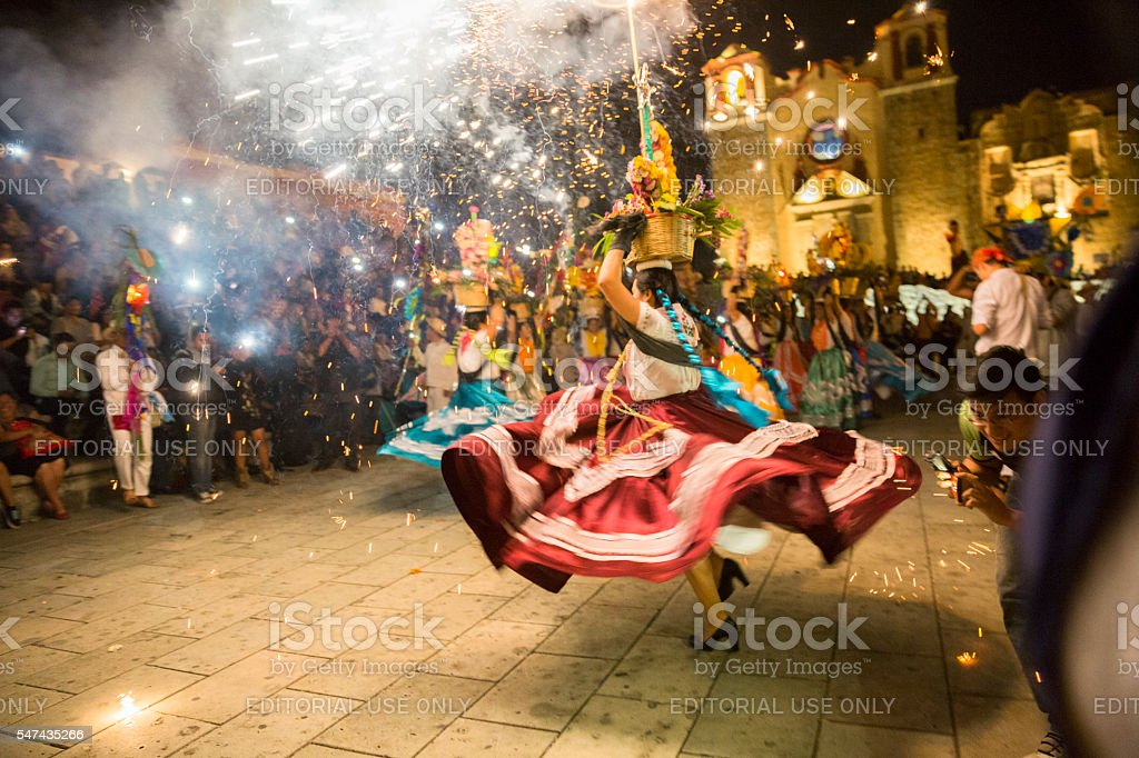 Women with China oaxaqueña traditional costume dancing for Guelaguetza celebration stock photo