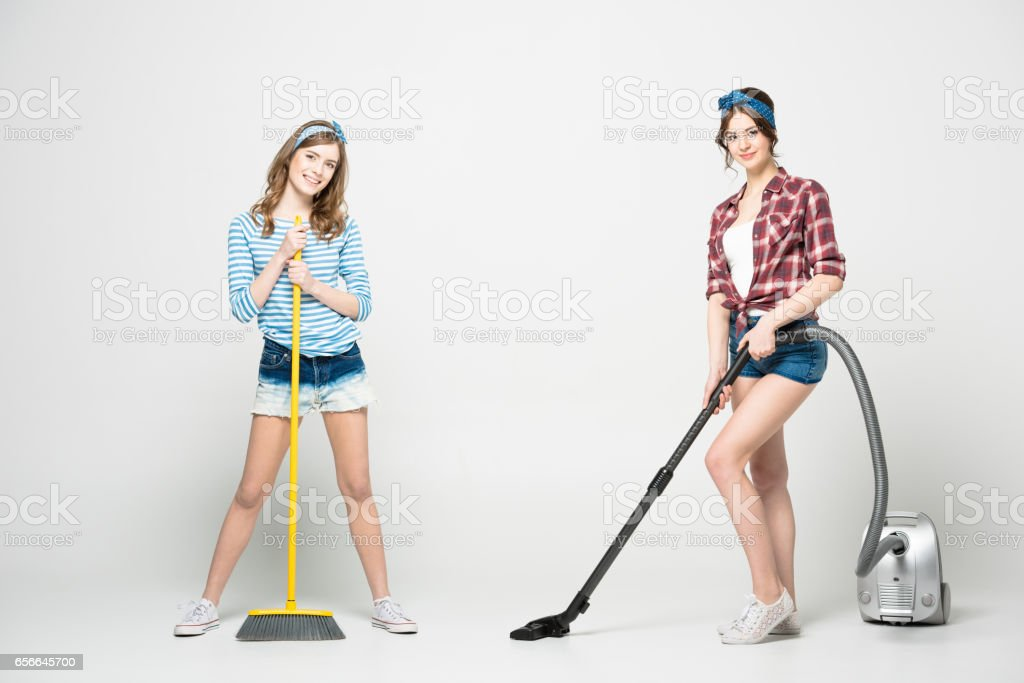 Women with cleaning appliances stock photo