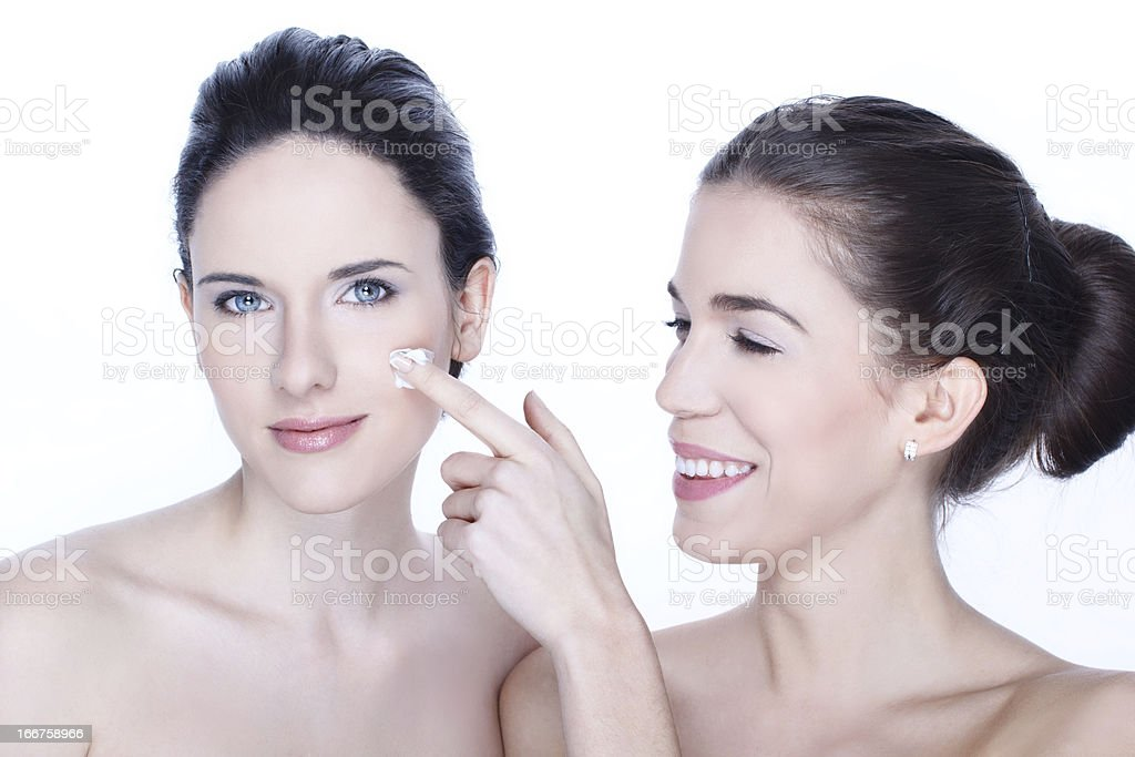 Women with cream on face royalty-free stock photo