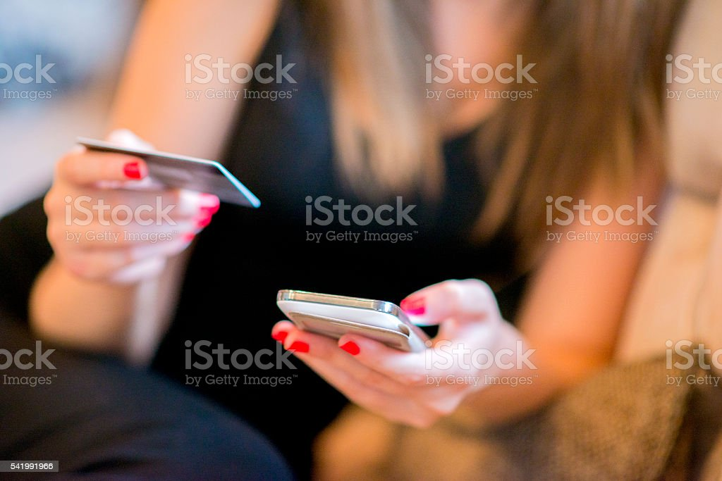 Women with credit card, Mobile Payment stock photo