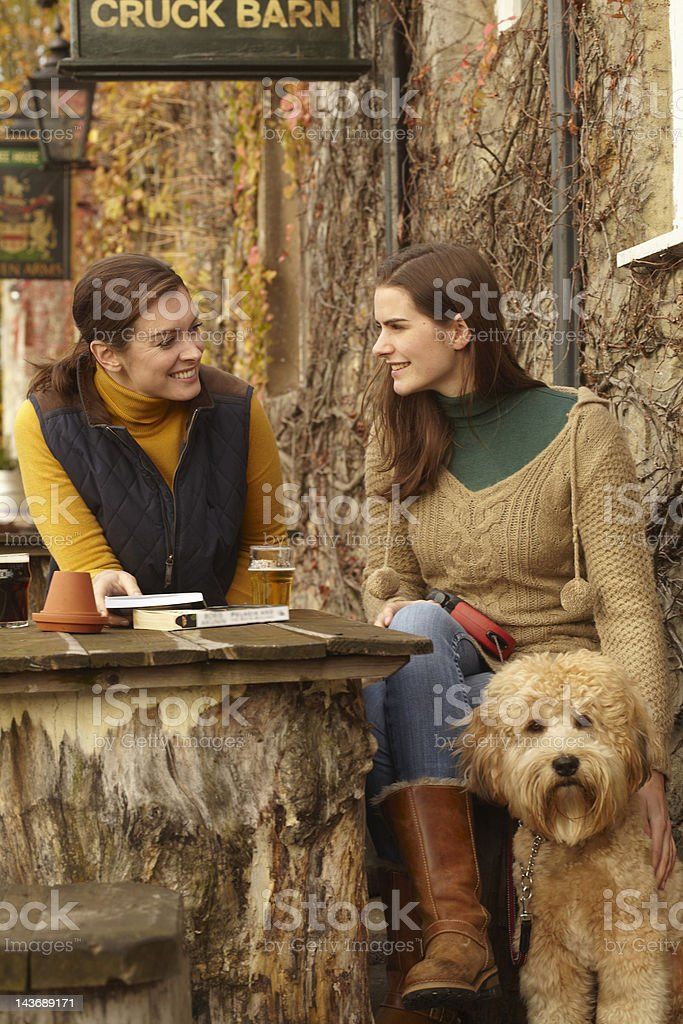 Women with dog having beer at cafe royalty-free stock photo