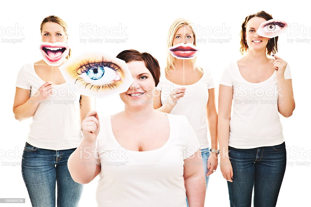 Women with eye and smile signs infront of them stock photo