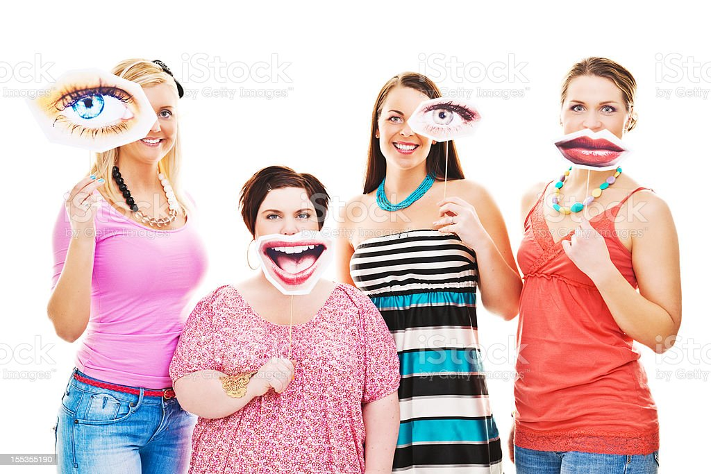 Women with eye and smile signs infront of them royalty-free stock photo