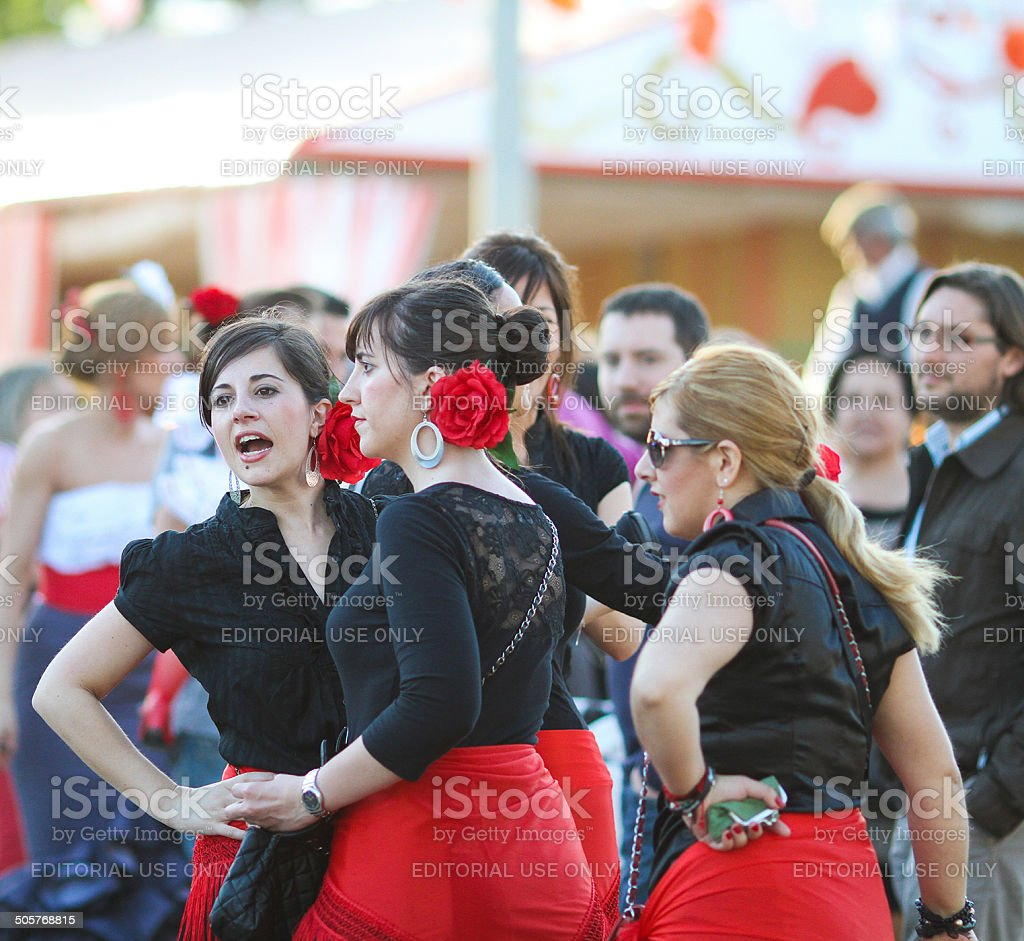 Women with flamenco dresses during the April Fair stock photo