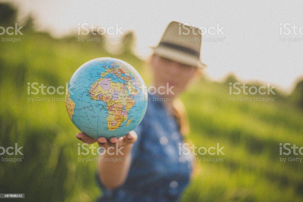 Women with globe stock photo