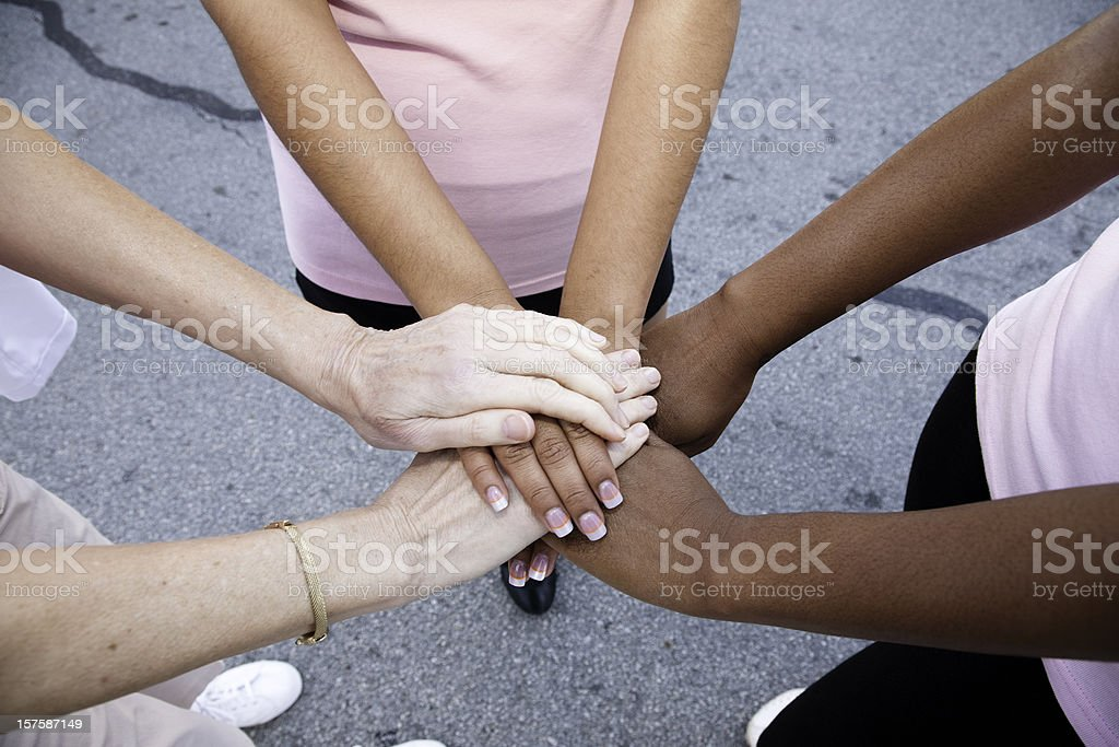 Women with Hands Together in a Circle royalty-free stock photo