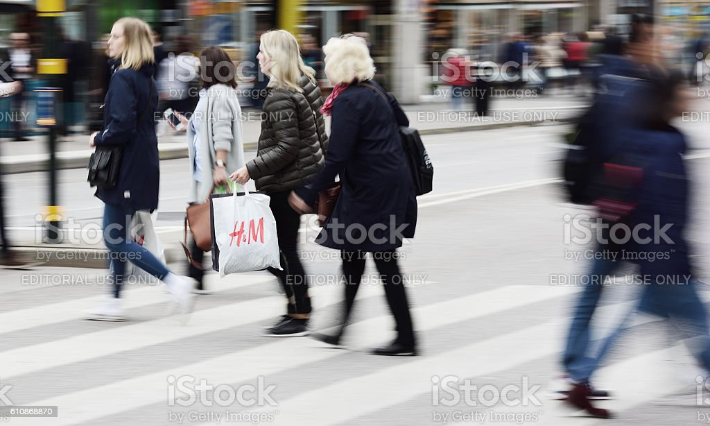 Women with H&M (H and M) bag stock photo