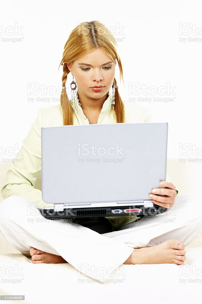 Women with laptop on couch royalty-free stock photo