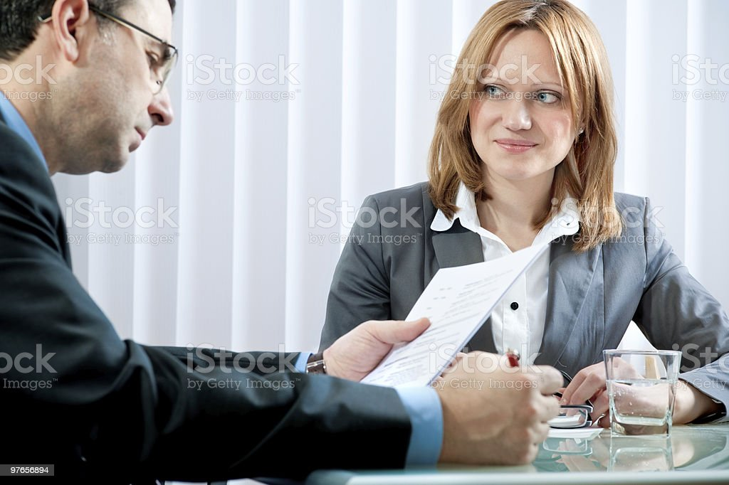 A women with light brown hair being interview for a job royalty-free stock photo