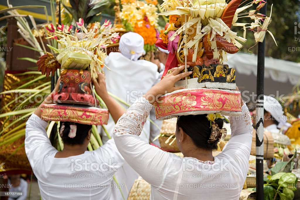Women with offerings fruits on head Bali stock photo