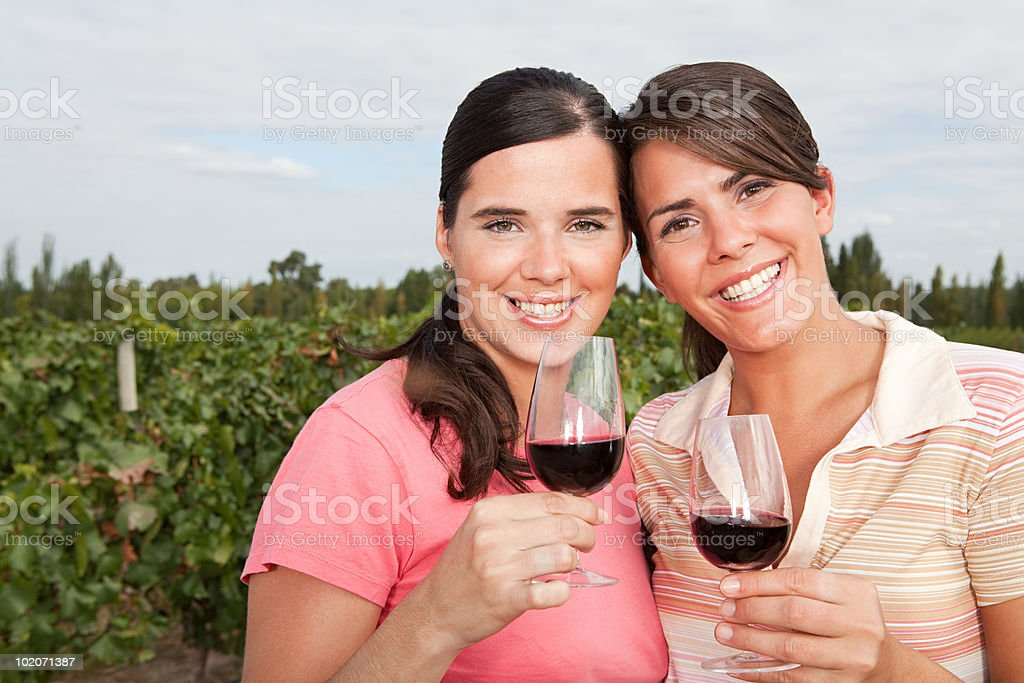 Women with red wine in vineyard royalty-free stock photo