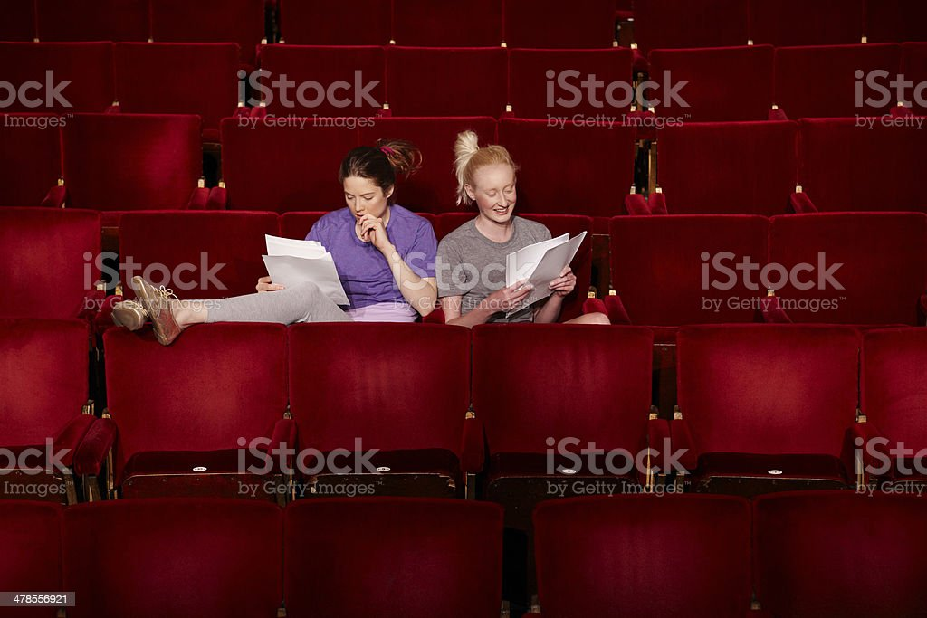 Women With Scripts At Theatre Stall stock photo