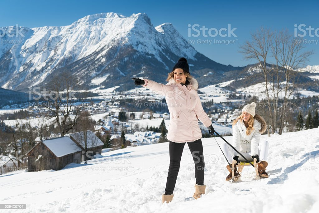 Women with sled outdoor in the Snow, Austrian Alps stock photo