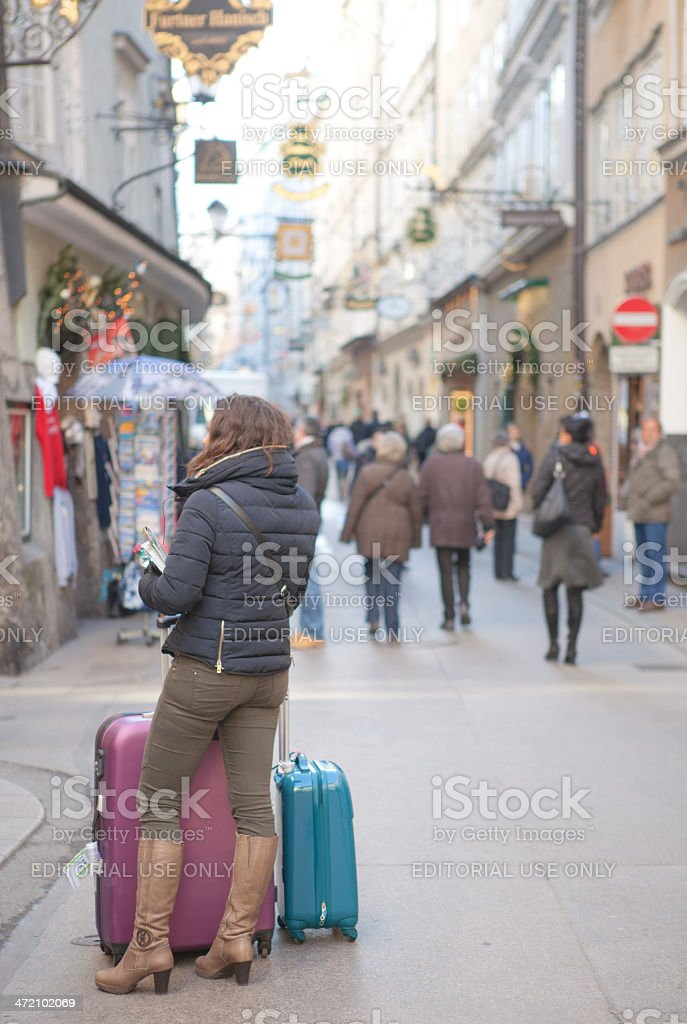 Women with suitcase in salzburg stock photo