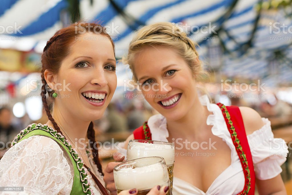 Women with traditional Bavarian clothes or dirndl in beer tent stock photo