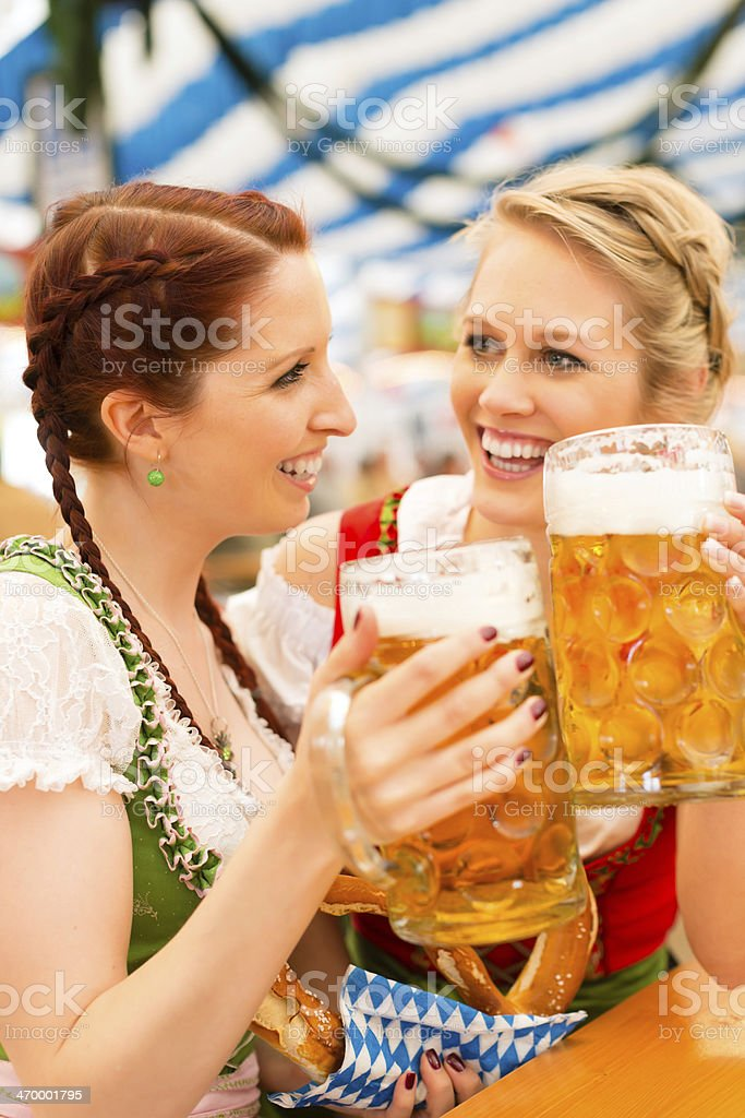 Women with traditional Bavarian dirndl in beer tent stock photo