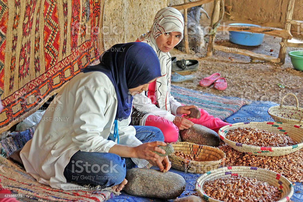 Women work in a cooperative for the manufacturing of argan stock photo