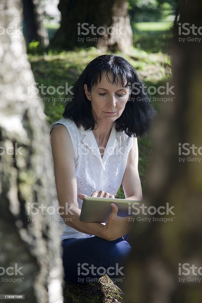women work on Tablet PC royalty-free stock photo