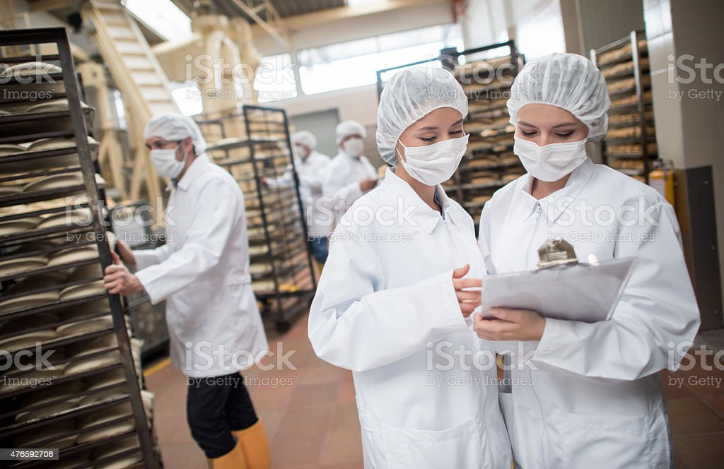 Women working at a food factory stock photo