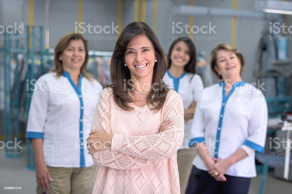 Women working at a laundry service stock photo