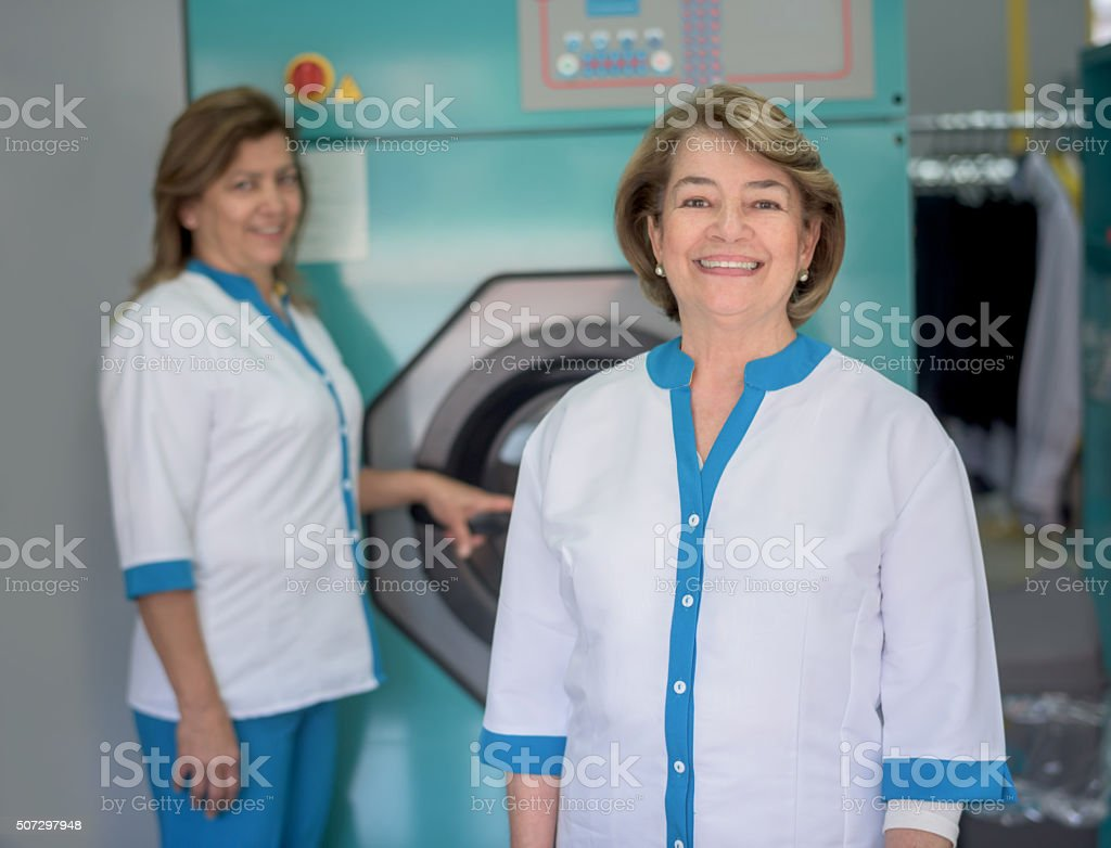 Women working at a laundry service shop stock photo