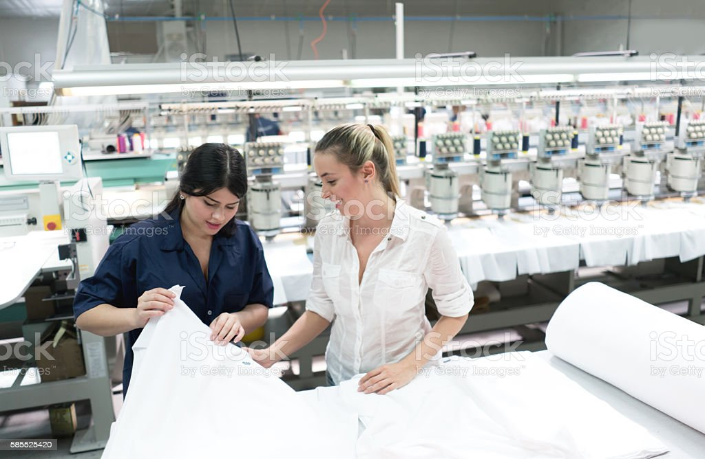 Women working at an embroidery factory stock photo