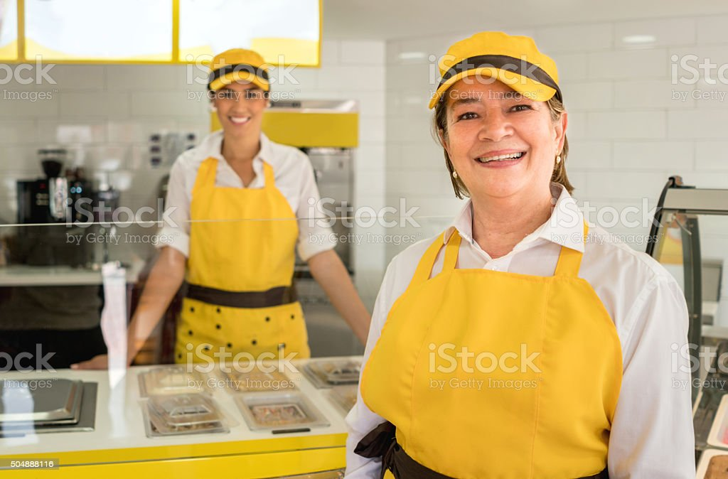 Women working at an ice cream shop stock photo