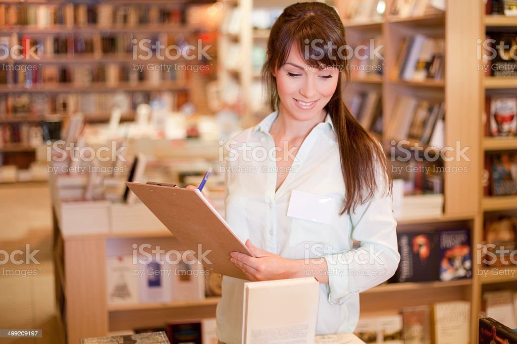 Women working at bookstore royalty-free stock photo