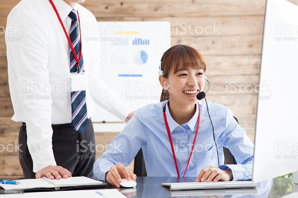 Women working in call center stock photo