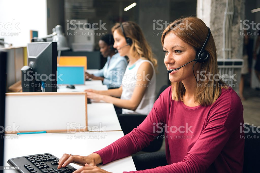 Women Working In Call Center. stock photo