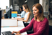 Women Working In Call Center.