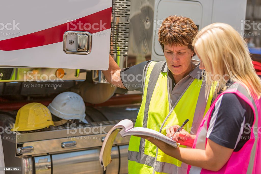 Women Working in the Transport Industry Wearing Hi-Vis Clothes stock photo