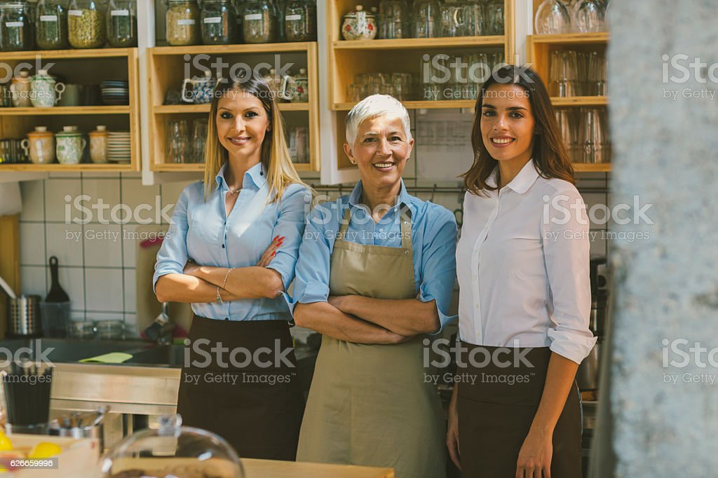 Women Working In Their Cafe stock photo