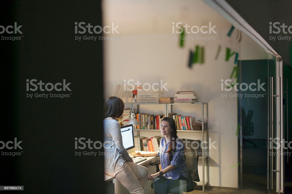 Women working together in design studio at night vector art illustration
