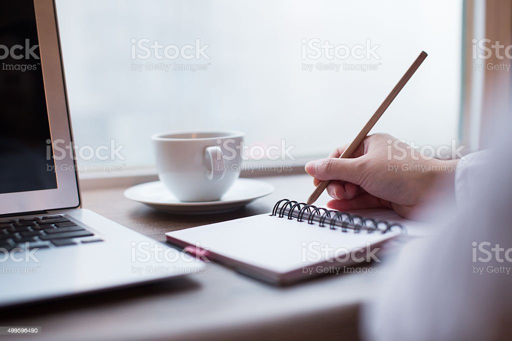 Women writing on table stock photo