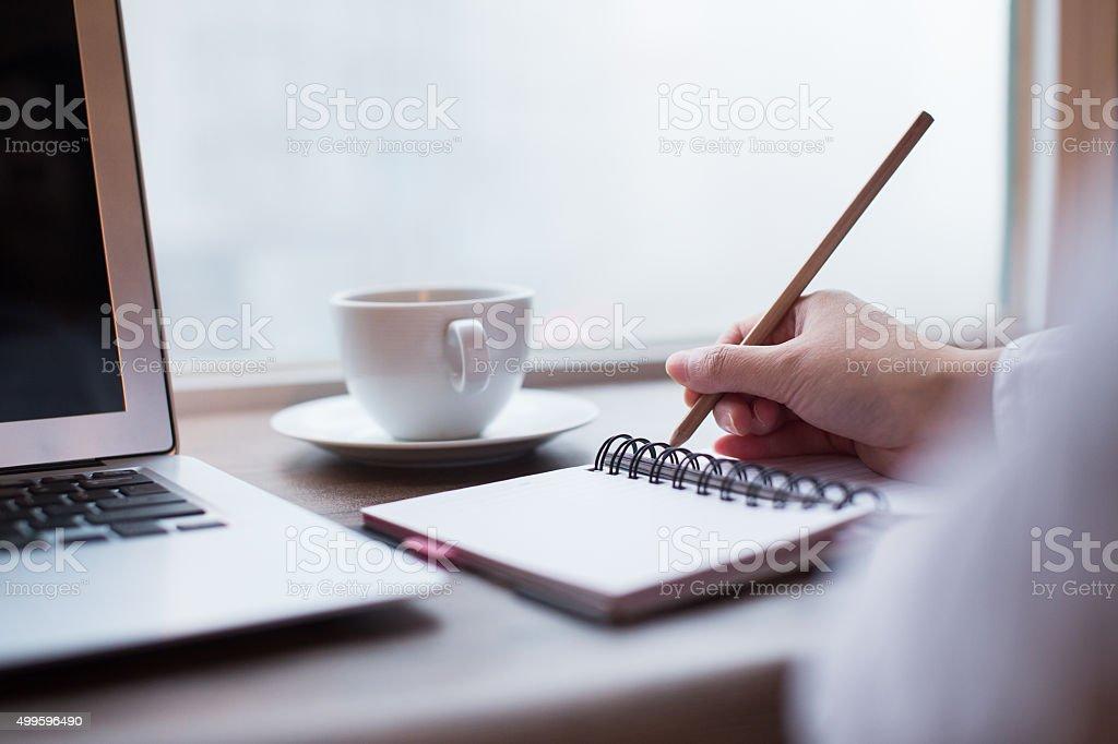 Women writing on table stock photo