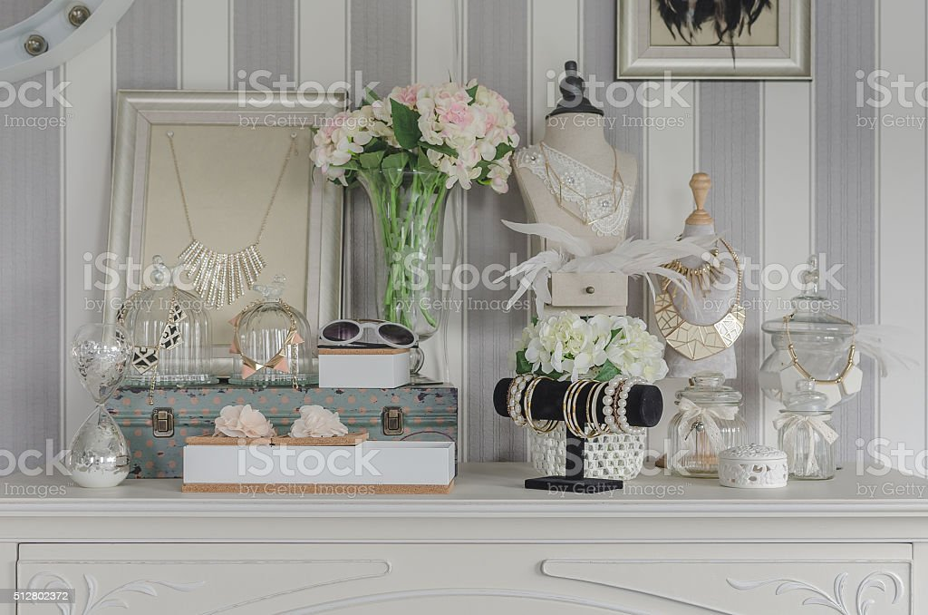 women's accesories on white dressing table stock photo