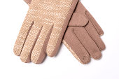 women's beige gloves isolated on white