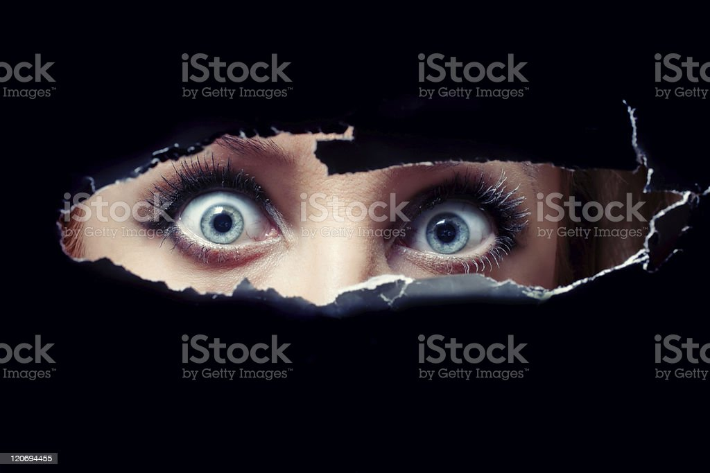 Women's blue eyes spying stock photo
