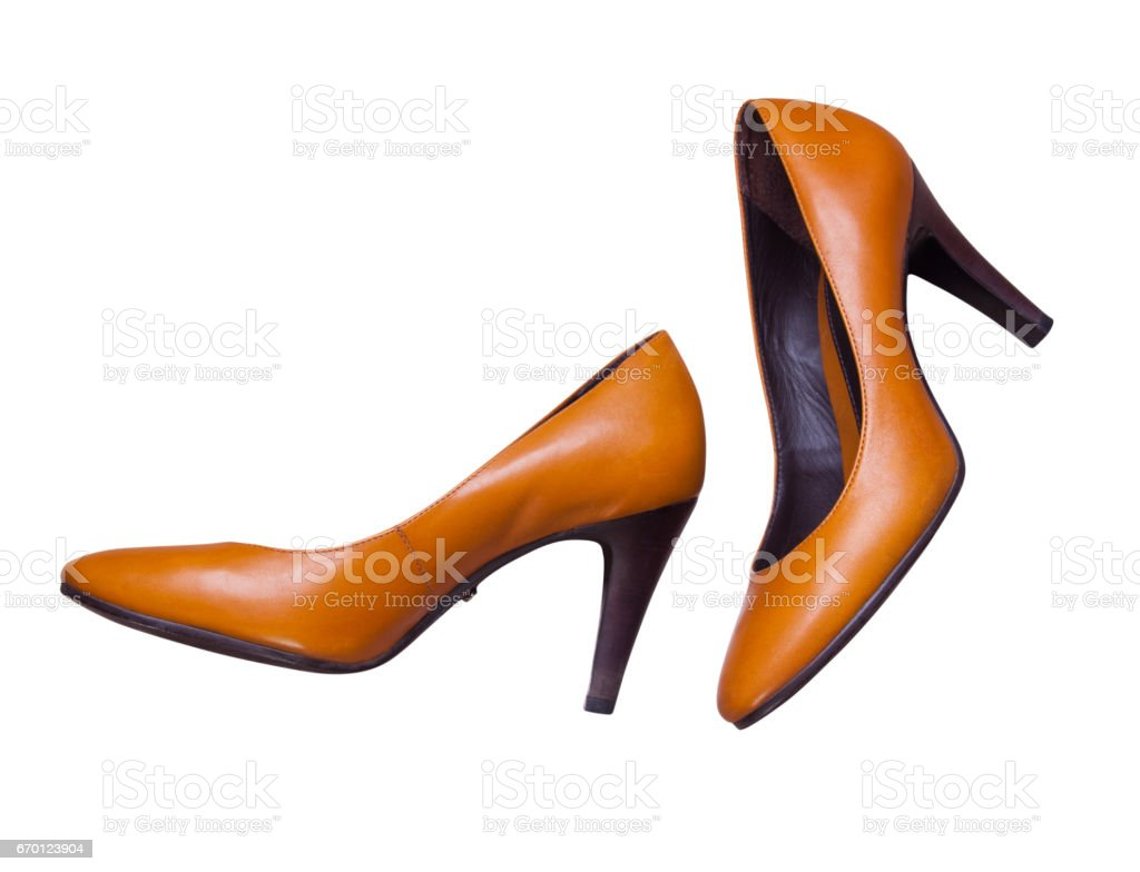 Women's brown shoes on a white background stock photo