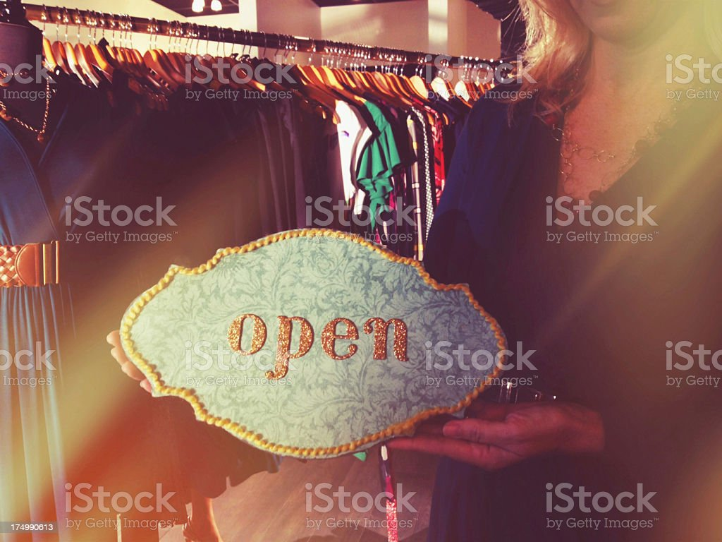 Women's clothing store open for business stock photo
