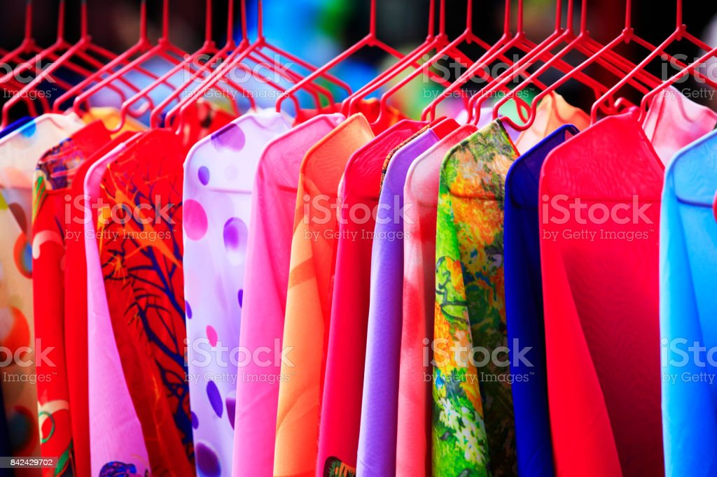 Women's clothing store. Women's clothes on rack in women's clothing store in shopping mall stock photo