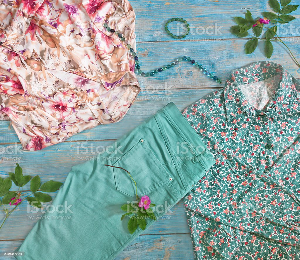 Womens clothing turquoise and pink color  flat lay. stock photo
